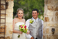 USA, Texas, Bride and groom with bridal bouquet, smiling - ABAF000270