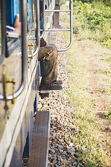 India, Tamil Nadu, Passenger travelling by Nilgiri Mountain Railway - MBE000550
