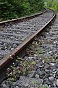 Germany, Bavaria, View of rail track with weed - AXF000252