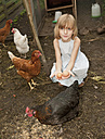 Germany, Brandenburg, Girl holding eggs on hen farm - BFRF000014
