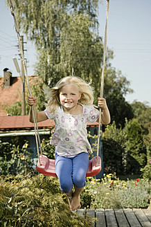 Germany, Bavaria, Girl swinging on swing - RNF001037