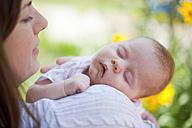 Germany, Bavaria, Mother holding baby girl - HSIYF000022