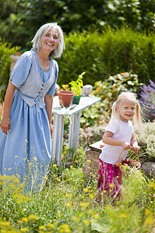 Germany, Bavaria, Mature woman with girl in garden - HSIYF000025