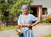 Germany, Bavaria, Mature woman with basket of fresh eggs - HSIYF000044