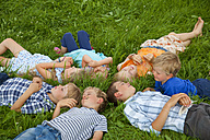 Germany, Bavaria, Group of children lying in meadow - HSIYF000054