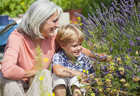 Germany, Bavaria, Mature woman with boy in garden - HSIYF000087