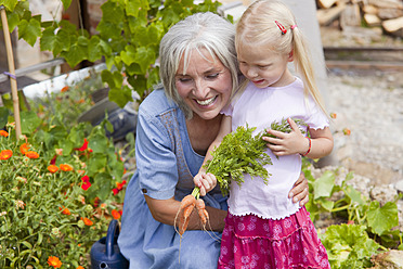 Germany, Bavaria, Mature woman with girl in garden - HSIYF000130