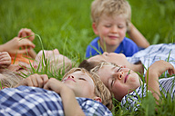 Germanny, Bavaria, Group of children lying in meadow - HSIYF000152