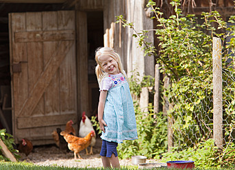 Germany, Bavaria, Girl with chicken on farm - HSIYF000104