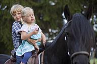 Germany, Bavaria, Boy and girl riding horse - HSIYF000102