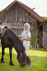 Germany, Bavaria, Mature woman with horse - HSIYF000099