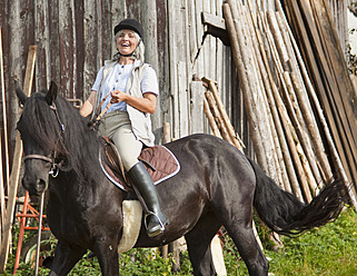 Germany, Bavaria, Mature woman riding horse - HSIYF000096