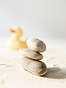 Stack stones and rubber duck on sand - FMKF000670