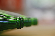 Germany, Close up of green bottles - JTF000043