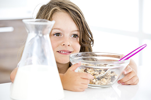 Germany, Girl eating muesli in kitchen - RFF000024
