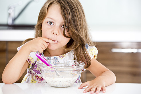 Germany, Girl eating muesli in kitchen - RFF000027