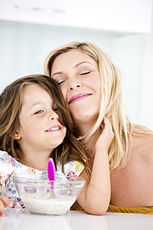Germany, Daughter touching mother, smiling - RFF000030