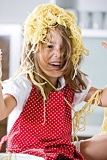 Germany, Girl playing with spaghetti - RFF000066