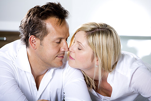 Germany, Mid adult couple touching nose - RFF000084