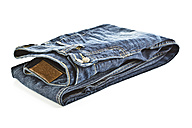 Close up of folded blue jeans on white background - MAEF005013