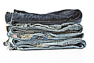 Variety of blue jeans on white background, close up - MAEF005017