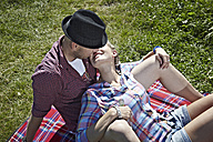 Germany, Cologne, Couple laying in grass - RHYF000245