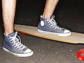 Germany, Duesseldorf, Human foot on skateboard, close up - STKF000030