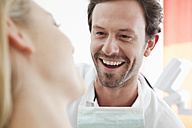 Germany, Dentist and patient in clinic, smiling - FMKYF000205