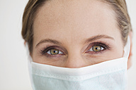 Germany, Close up of dentist with surgical mask - FMKYF000214