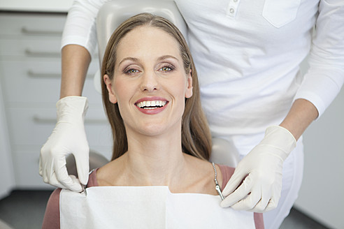 Germany, Patient and dentist in dental office - FMKYF000229