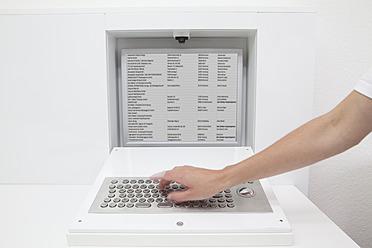 Germany, Dentist using keyboard - FMKYF000250