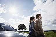 Germany, Bavaria, Couple standing by car - RBF001080