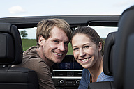 Germany, Bavaria, Couple in car, smiling - RBF001083