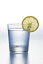 Glass of water with lemon slice on white background - ASF004646
