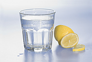 Glass of water with lemon slice on white background - ASF004643