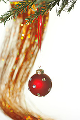 Germany, Christmas bauble hanging to tree, close up - JTF000174
