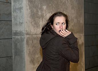 Germany, Berlin, Young woman running through street - BFRF000086