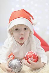 Boy holding christmas bauble, portrait - MJF000160