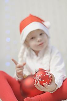 Boy holding christmas bauble, portrait - MJF000158