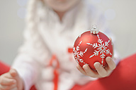 Boy holding christmas bauble, close up - MJF000157