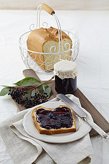 Elderberry jam with white bread on wooden table - ECF000117