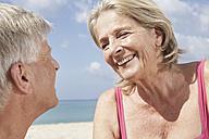 Spain, Mallorca, Senior couple sitting at beach - PDYF000208