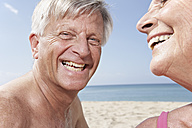 Spain, Mallorca,  Happy senior couple  at beach - PDYF000271