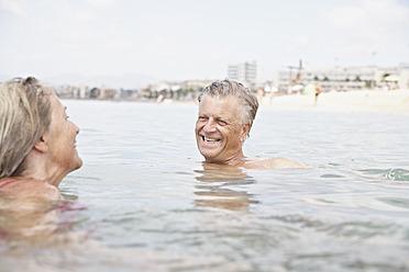 Spain, Senior couple swimming in sea - PDYF000241