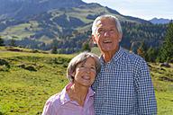 Germany, Bavaria, Senior couple on mountain hike near Wendelstein - TCF002982