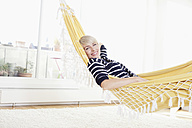 Germany, Bavaria, Munich, Woman relaxing in hammock, portrait - RBYF000223