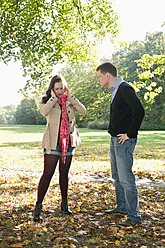 Germany, Berlin, Couple arguing in autumn park - BFRF000123