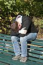 Germany, Berlin, Depressed man sitting on park bench - BFRF000129