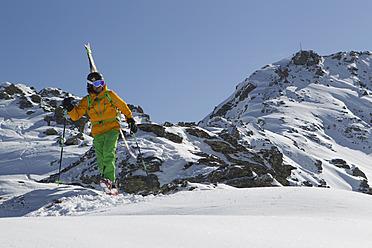 Austria, North Tirol, Mature man skiing - FFF001319