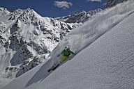 Austria, Tirol, Mid adult man doing freeride skiing - FFF001320